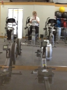 On the stationary bike, a little blurry because it's an action shot!